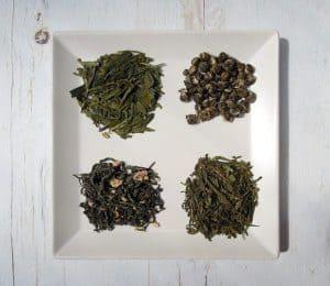 Четыре сорта зеленого чая на тарелке